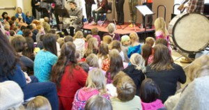 children watching a musical performance